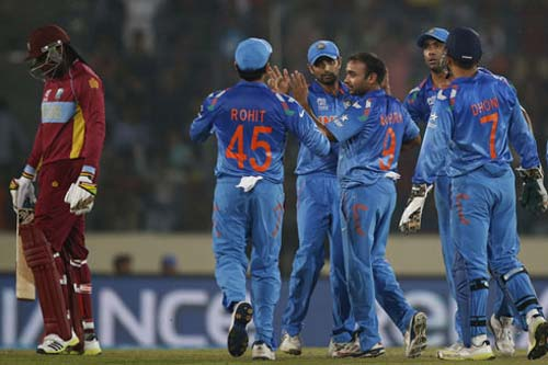 India enter quarter-finals after defeating WI by four wickets