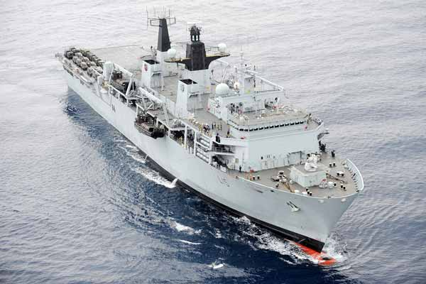 HMS Bulwark and Merlin helicopters ready for operations in the Mediterranean