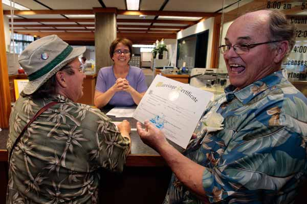 After legalization of gay marriage immediate wedding vows seen in Michigan