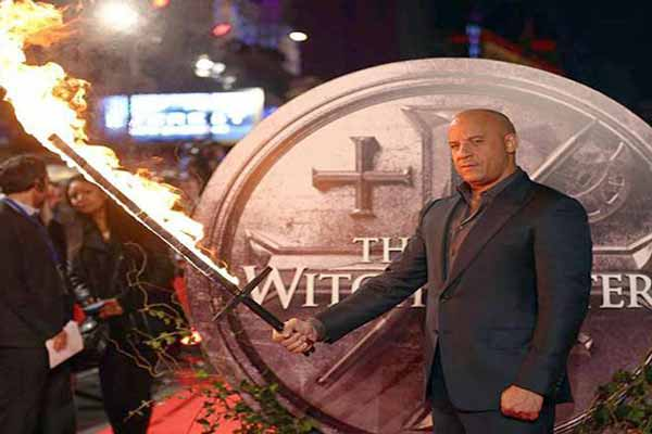 Vin Diesel wields flaming sword at the premiere of