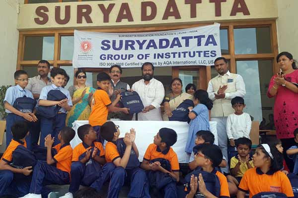 Suryadatta Distributes 200 school bags sets containing 10 Note Books & compass box to needy & deserving students of drought affected Beed District