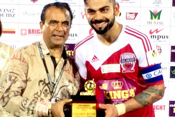 Yogesh Lakhani, CMD of Bright Outdoor Media gave man of the match trophy to Virat Kohli