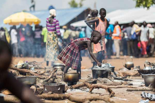 UN and Ugandan government cut food rations amid influx of South Sudanese refugees