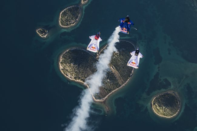 Flight above the Island of Love The skydive trio flies in formation above a heart-shaped island