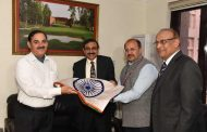 Mr. Parthasarathy, Mahindra Group CFO presents flags to BSF