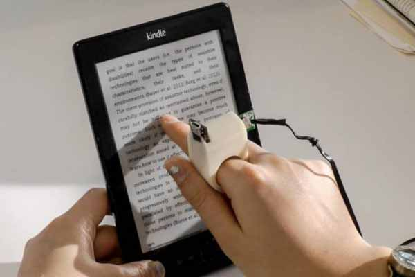 Finger-mounted reading device for the blind