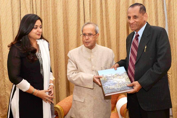 President of India presents copy of book on Rashtrapati Nilayam to Governor Narasimhan