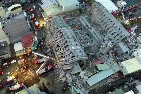 11 Dead more than 30 trapped after powerful Taiwan quake fells buildings