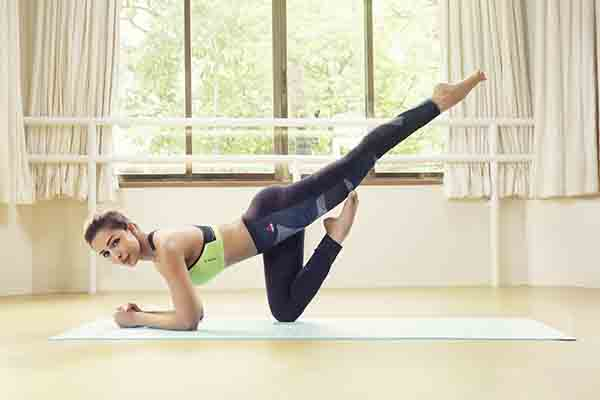 buy popular f1535 0d7ec Style icon Malaika Arora goes fit with Reebok s all-new Yoga collection